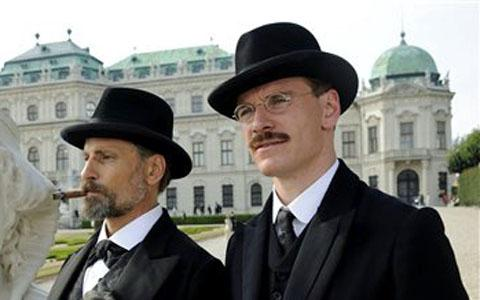 "Viggo Mortensen plays Sigmund Freud, left, and Michael Fassbender plays Carl Jung in the film ""A Dangerous Method."""
