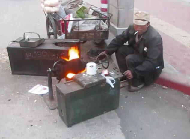 The vendor turns the cannister over an open flame